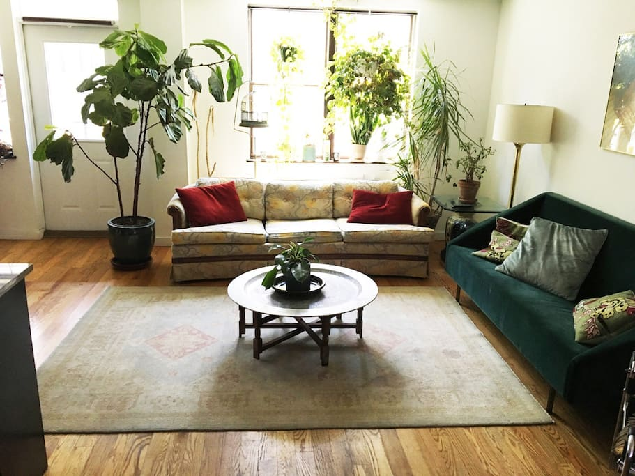 Large living room with vintage furniture pieces and flat screen TV with Apple tv
