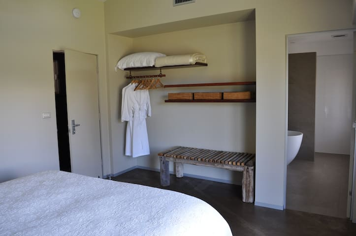Girragirra. Bespoke furniture and en- suite bathrooms in both bedrooms