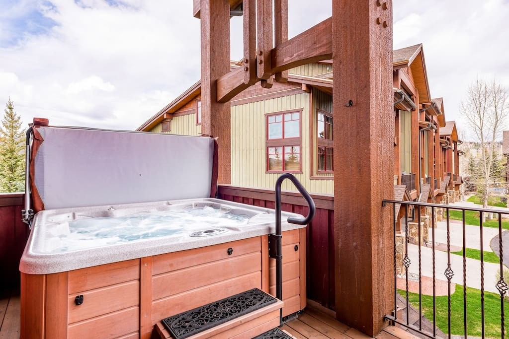 Enjoy a relaxing dip in the private hot tub on the balcony.