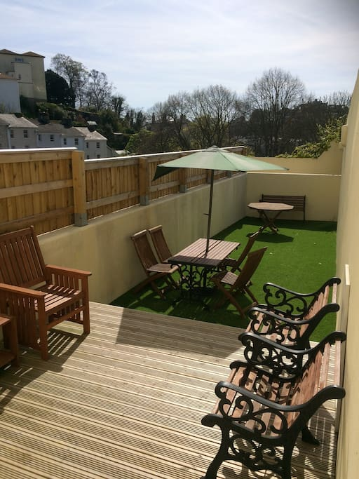Sunny decked garden area. Private garden.
