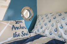 Fun porthole in nautical themed space