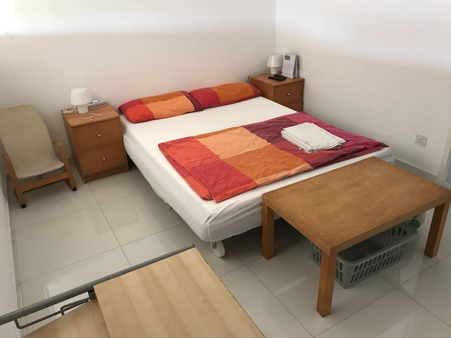 room includes Queen size bed and table