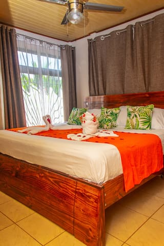 Master bedroom with comfortable KING size bed & Safety box, TV and A/C.