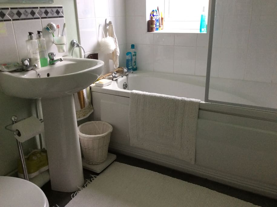 Bathroom with shower over bath, towels available for your convenience