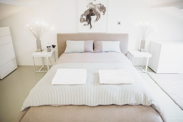 Master mezanine bedroom, with plenty of storage and cupboard space. New, luxurious and incredibly comfy mattress. LED reading lights and Bluetooth digital radio.