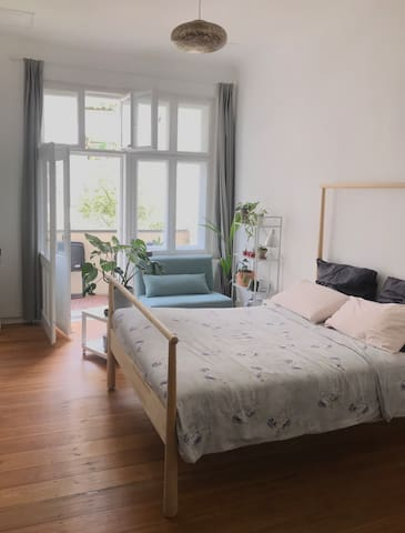 Bright and chilly bedroom with private balcony