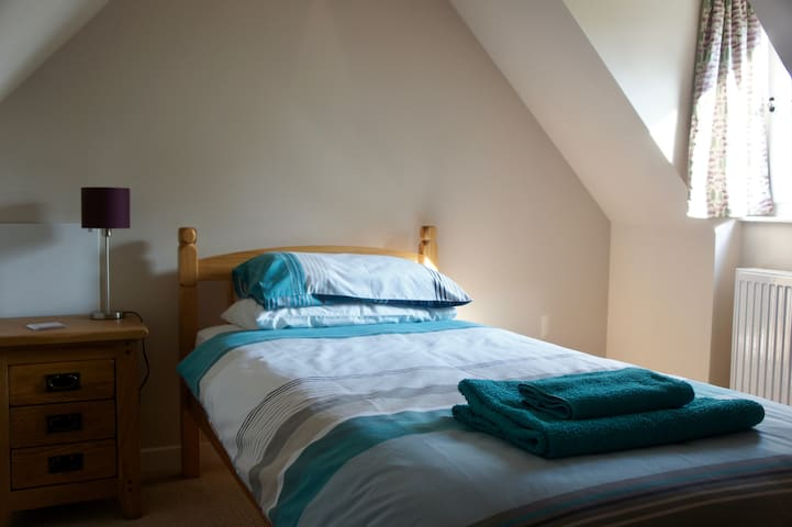 Third bedroom with single bed. This room is accessed via the second bedroom.