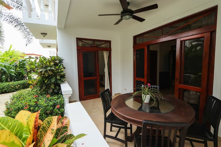 La Paloma Blanca 1G - Charming Garden View Apartment in an Exclusive Oceanfront Community