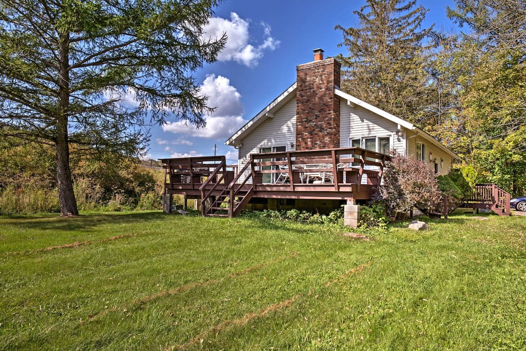 The house is located on a quiet property, surrounded by the Catskill Mountains.