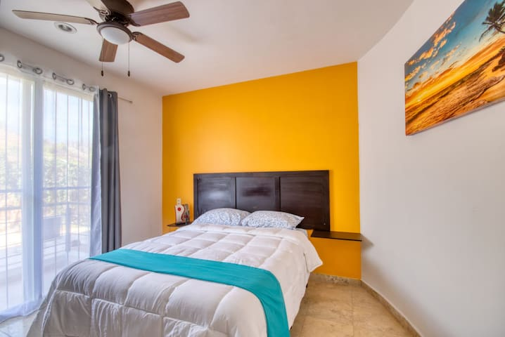Recharge and rest in this cozy queen-size bed with closet and mountain view. Your dreams are safe with blackouts courtains in every room