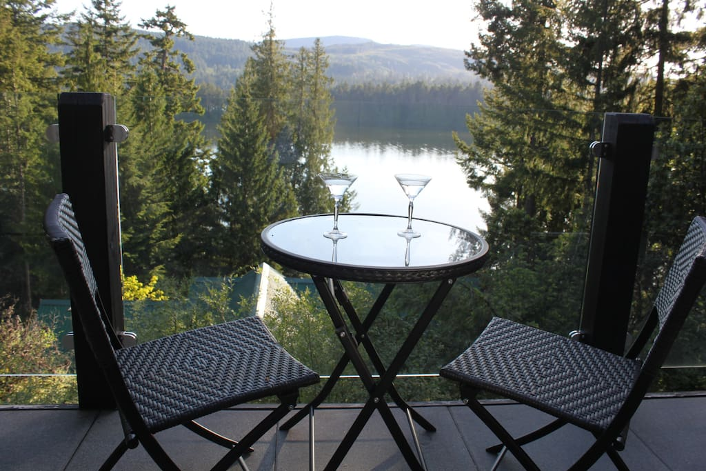 Enjoy a treetop westward view of Shawnigan Lake from a full size deck, finishing your day with peaceful quiet.