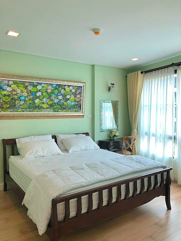 This is the main bedroom with a beautiful painting from a famous artish in Huahin Mr. Chomadee