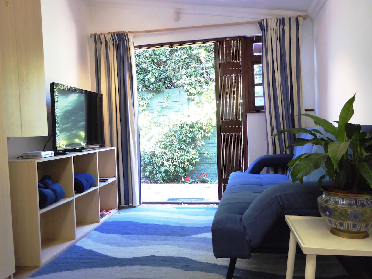The cosy sitting room with a comfy sleeper couch, satellite TV, free uncapped wifi, a private patio.  The cottage has a separate entrance & secure parking.