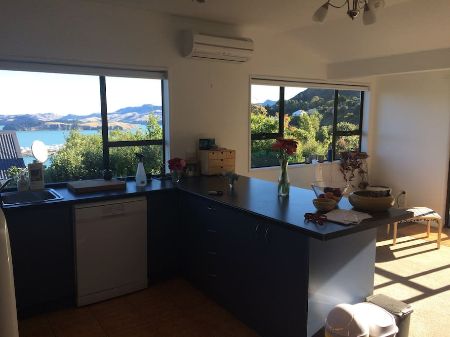Kitchen/dining room with amazing views of the Lyttelton basin.