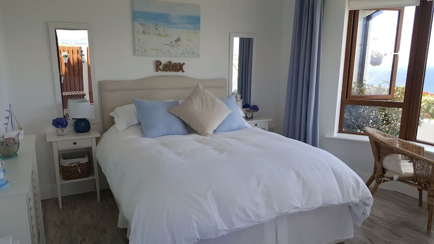 Bedroom decorated in coastal theme will make sure you get that seaside feeling! This is an incredibly comfy bed! And it also has drawers for storage