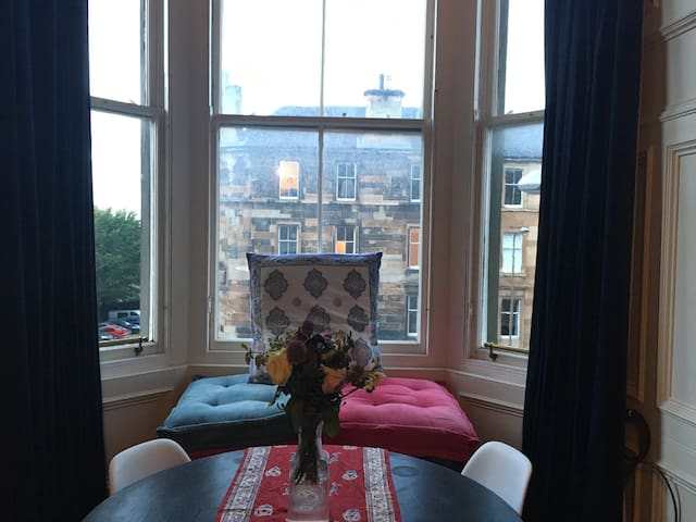 Sit in the window on comfy cushions, if you like!
