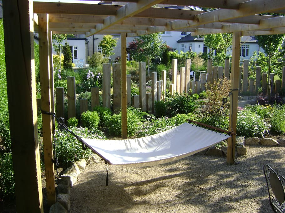 Enjoy my 2 hammocks at the back of the garden for serious relaxation.