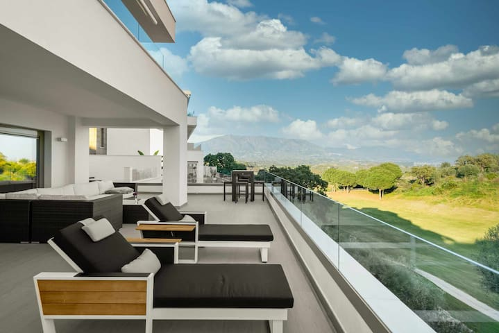 Modern front line golf corner apartment with large sunny terrace
