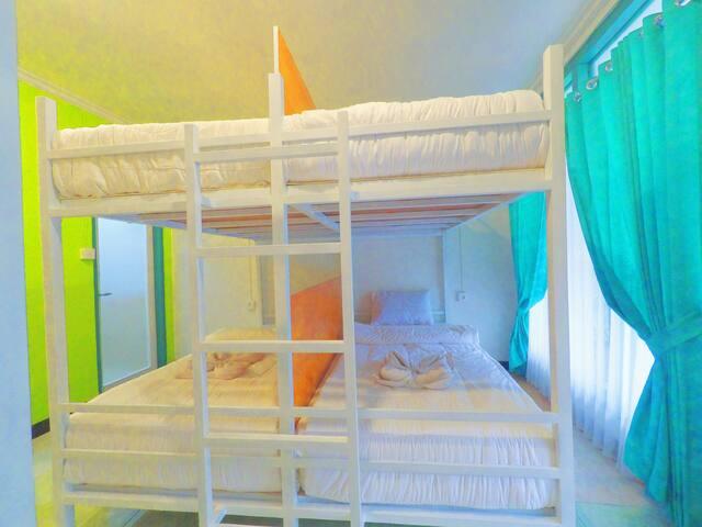 A bed in a dorm room at Coastal inn