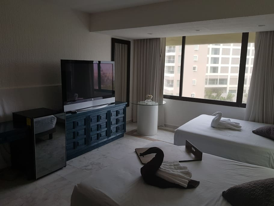 """Master room with 2 brand new Queen beds & 60"""" smart tv with Roku tv and cable."""