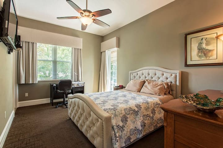 queen suite w/ private bathroom, wireless head set for the TV, black out blinds and private desk
