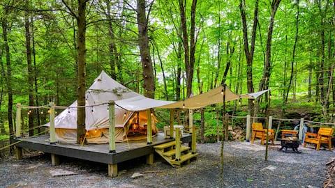 Glamping yurt overlooking waterfall