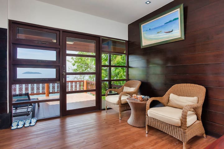 Living room with private balcony with a sea view.