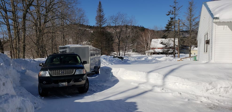Driveway connects to restaurant parking lot in the winter for easy of trailers in tow.