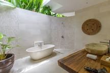 Upstairs bathroom, complete with a relaxing terrazzo bathtub and mosaic shower.