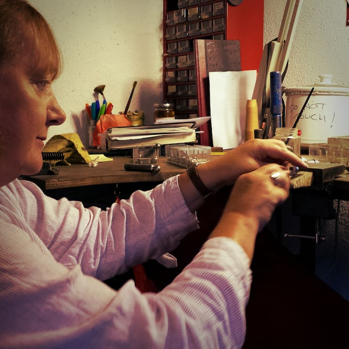 Student working on her silver pendant