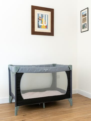 A folding travel cot is available for younger guests