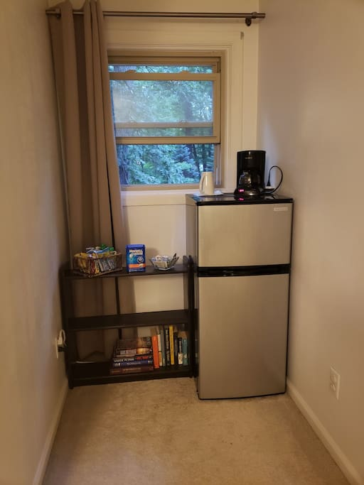 A little book and coffee nook, complete with your own refrigerator. Not pictured: microwave also in room for your convenience!