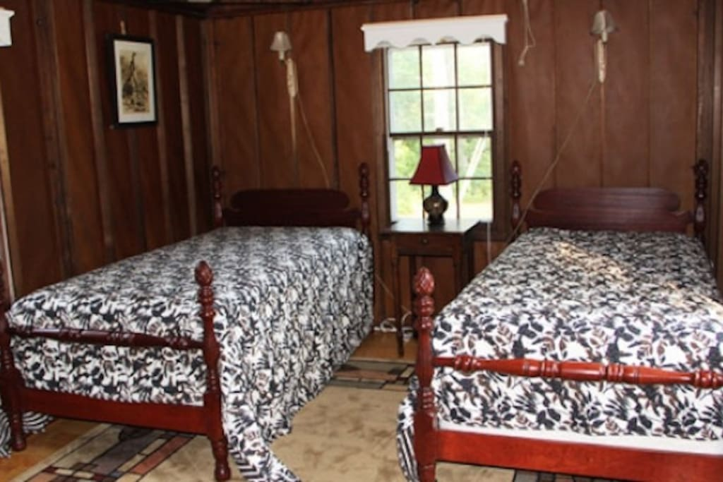 Twin beds at the Cottage.