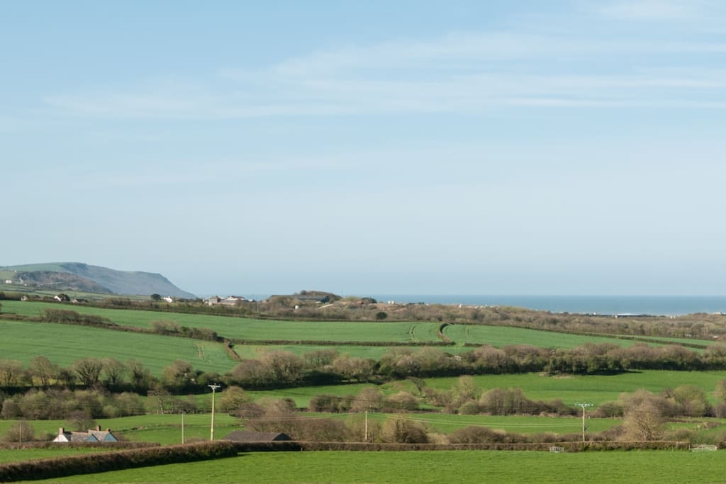 View from bedroom window over the fields to Widemouth Bay