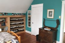West bedroom built-in bookshelves, closet and antique wash stand.