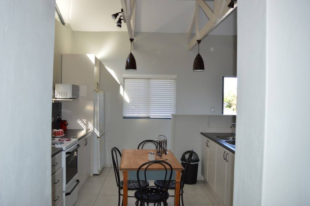 Fully equipped kitchen and small dining table