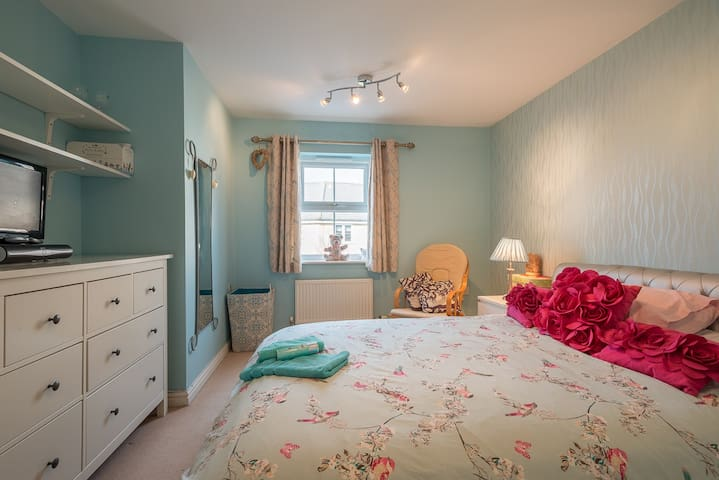 King size bed, spacious bedroom with plenty of storage.