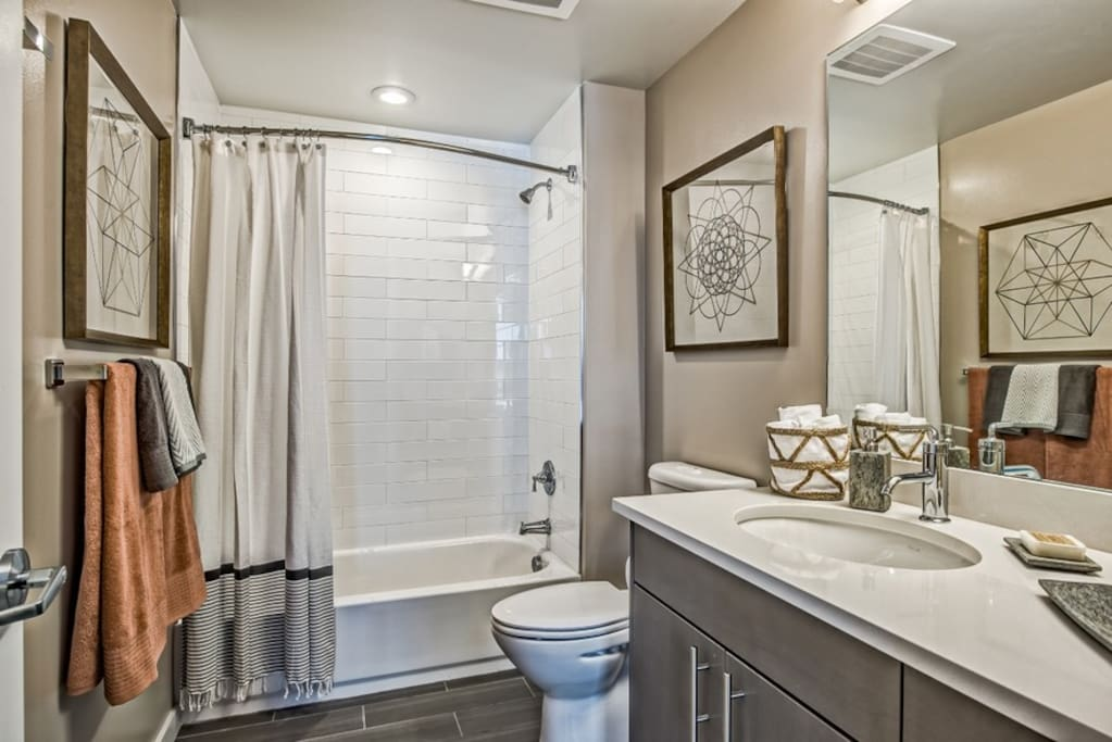 Bathroom with shower, oval soaking tub combo.