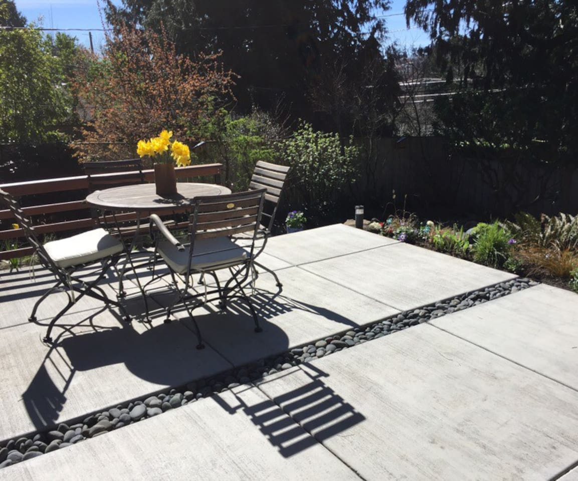 Sunny backyard patio. Enjoy morning coffee and scones, or a beverage after an adventurous day.