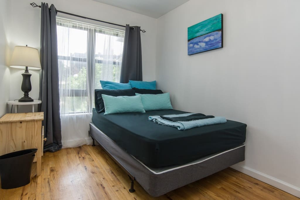 clean comfortable bedroom with yard view and closet