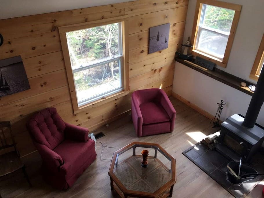 Living room including woodstove (includes futon, not shown)