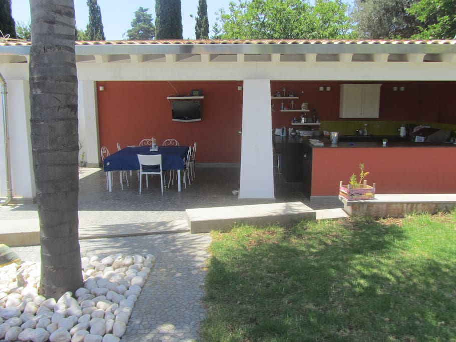 The outdoor kitchen & dining area