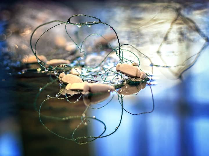 Close up of fishing net in paper pulp