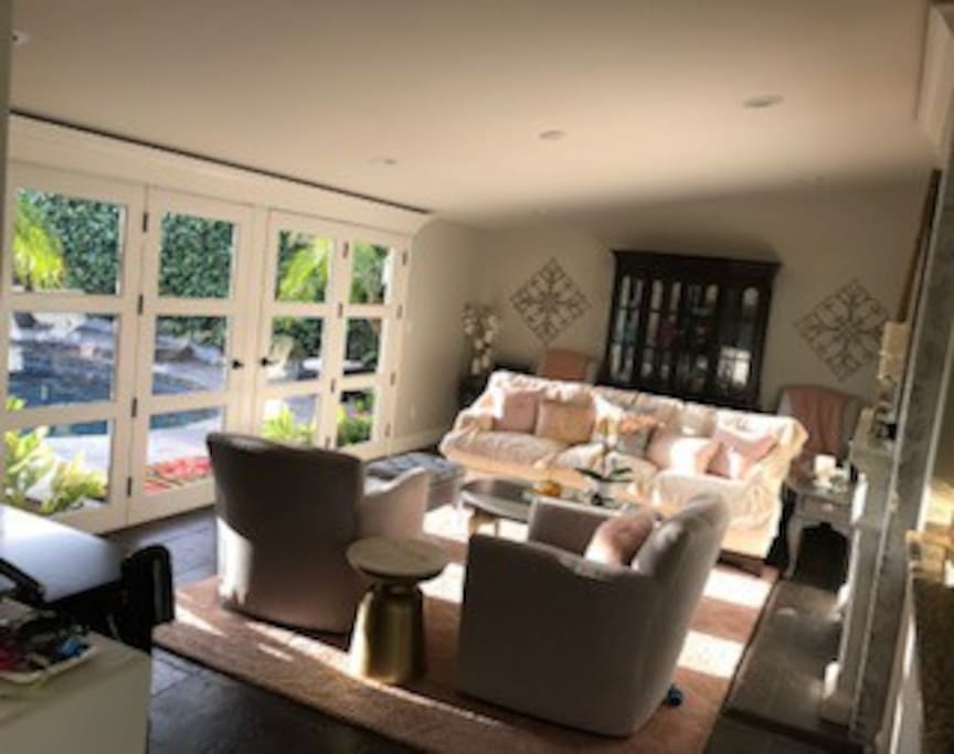 Shared Indoor/Outdoor living room leading to resort style pool
