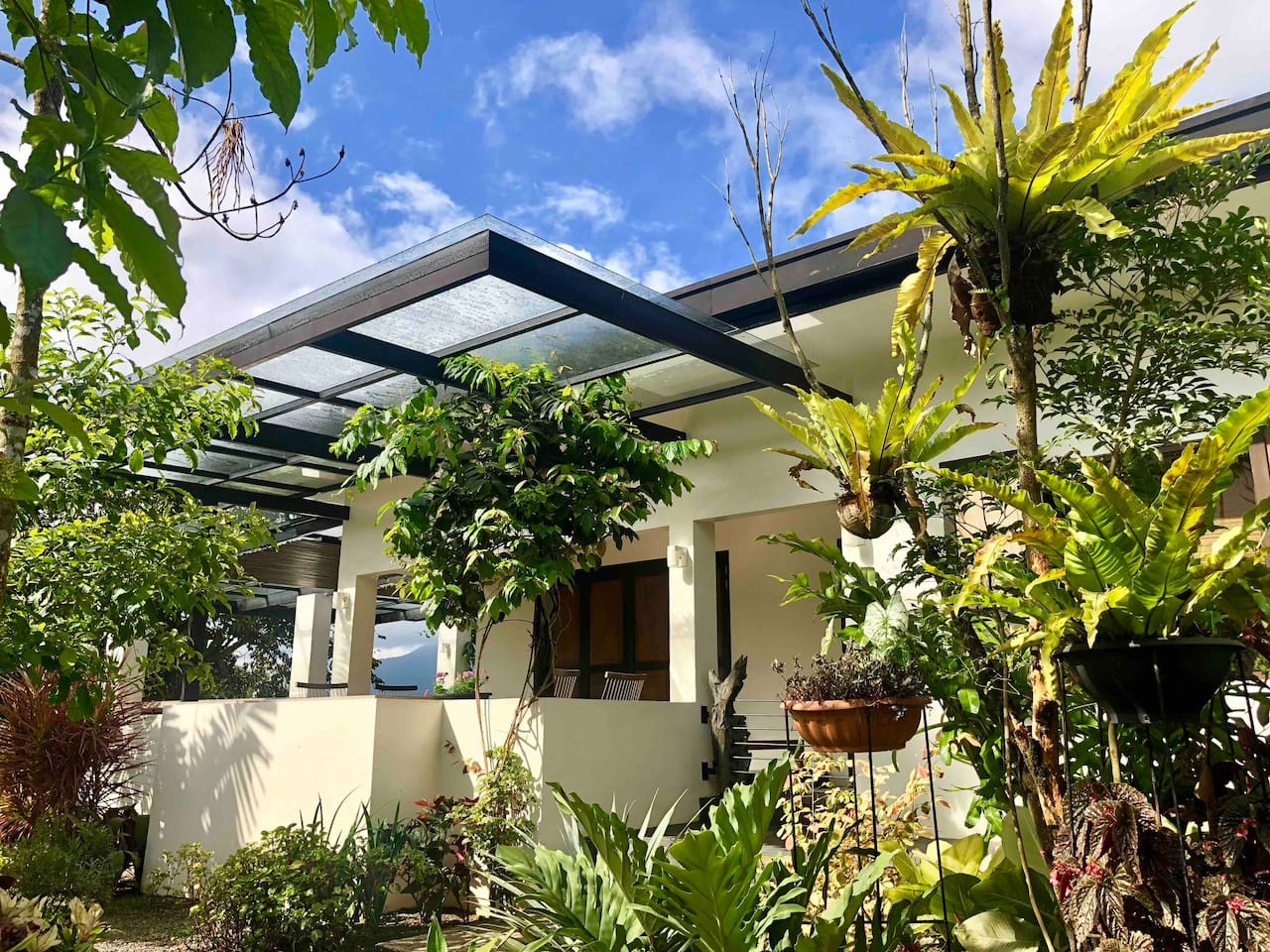 Facade of house. 3 Bedrooms, 2 bathrooms, sala, kitchen and lanai all on one level. Convenient for elderly / handicapped guests.