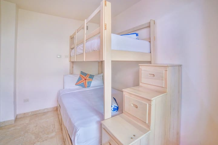The third bedroom has a bunk bed with a double bed on the bottom and a single bed on top.