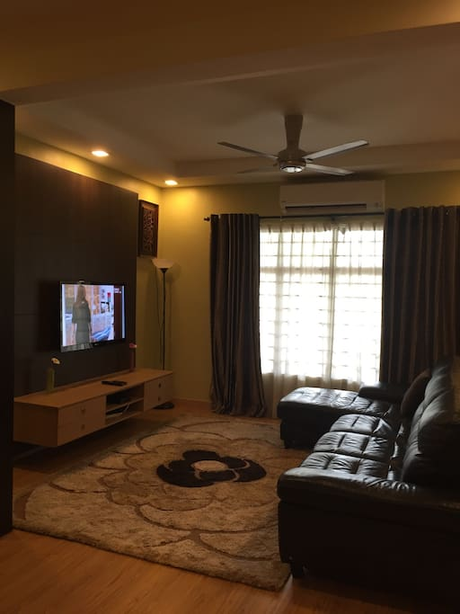 """Living hall with built-in tv console + Sharp 42"""" tv + Lorenzo L-shape leather sofa"""
