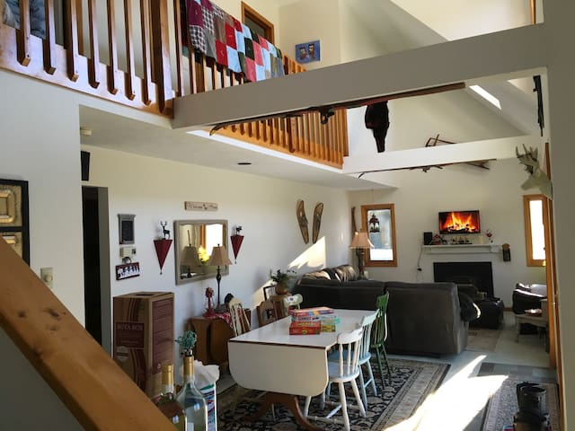 Dining and living area with pellet stove