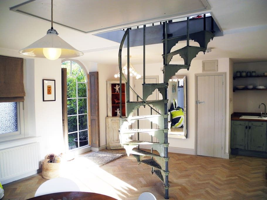 Light, airy Coach House with a reclaimed spiral staircase.