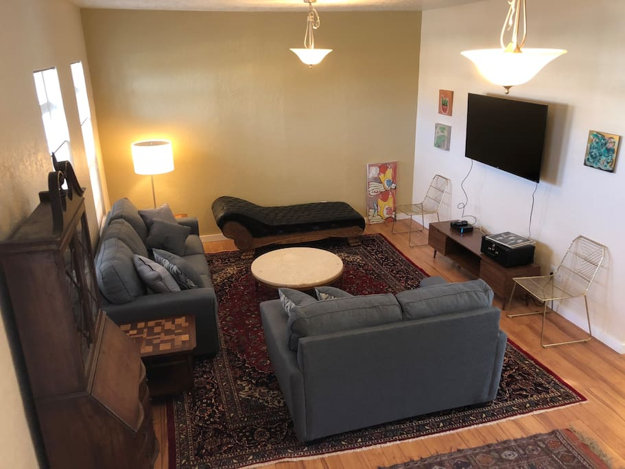 Cozy living room with cable TV and sleeper sofa.
